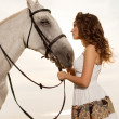 Young woman on a horse. Horseback rider, woman riding horse on b — Stock Photo