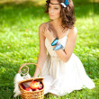 Stock Photo: Beautiful girl on picnic on nature. Beautiful Young girl Outdoor