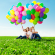Happy family holding colorful balloons. Mom, ded and two daughte — Stock Photo #38545969