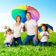 Happy family together in outdoor park at sunny day. Mom, dad an — Stock Photo #38546031