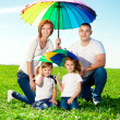 Happy family in outdoor park at sunny day. Mom, dad and two dau — Stock Photo #38546033