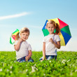 Two little girls in outdoor park at sunny day. Sisters in the — Stock Photo #38546035