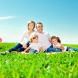 Happy family in outdoor park at sunny day. Mom, dad and two dau — Stock Photo