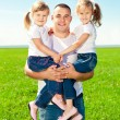 Happy family together in outdoor park at sunny day. Dad and two — Stock Photo #38546083