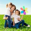 Happy family in outdoor park at sunny day. Mom and two daughter — Stock Photo