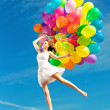 Stock Photo: Beauty young stylish womwith multi-colored rainbow balloons i