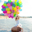 Beauty young stylish woman with multi-colored rainbow balloons i — Stock Photo