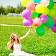 Happy birthday woman against the sky with rainbow-colored air ba — Stock Photo #38546455