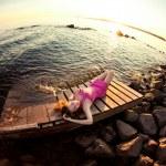 Beauty woman on the beach at sunset. Enjoy nature. Luxury girl r — Stock Photo #38546671