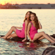 Two beauty women on the beach at sunset. Enjoy nature. Luxury gi — Stock Photo