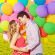 Stock Photo: Young healthy beauty pregnant womwith her husband and balloon