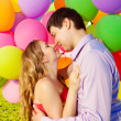 Young healthy beauty pregnant woman with her husband and balloon — Stock Photo #38546809