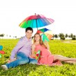 Stock Photo: Young healthy beauty pregnant womwith her husband and rainbow