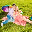 Stock Photo: Young healthy beautiful pregnant woman with her husband and rain