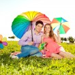 Young healthy beauty pregnant woman with her husband and rainbow — Stock Photo #38546851