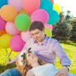 Young healthy beauty pregnant woman with her husband and balloon — Stockfoto #38546865