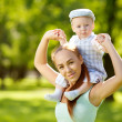 Stock Photo: Cute little baby in park with mother on grass. Sweet bab