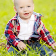 Stock Photo: Cute little baby in summer park on grass. Sweet baby outdoo