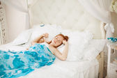 Young woman in bed in the morning — Stock Photo