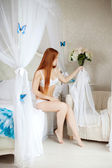 Young woman in bed in the morning — Foto de Stock