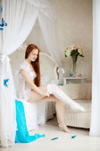 Young woman in bed in the morning — 图库照片