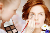 Stylist makes makeup bride on the wedding day — Stok fotoğraf