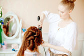 Hair stylist makes the bride on the wedding day — Stock Photo