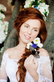 Beauty bride in a luxurious interior with flowers — Stock Photo