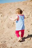 Cute little baby girl on the beach — Stock Photo