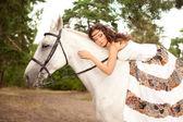 Young woman on a horse. Horseback rider, woman riding horse — Foto de Stock