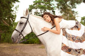 Young woman on a horse. Horseback rider, woman riding horse — Stock Photo