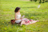 Beautiful woman on picnic on nature. Beautiful Young girl Outdoo — Stock Photo