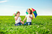 Two little girls in outdoor park at sunny day. Sisters in the — Stock Photo