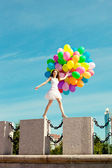 Happy birthday woman against the sky with rainbow-colored air ba — Stock Photo