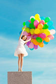 Happy birthday woman against the sky with rainbow-colored air ba — Stok fotoğraf
