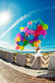 Happy birthday woman against the sky with rainbow-colored air ba — Photo