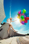 Happy birthday woman against the sky with rainbow-colored air ba — 图库照片