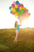 Sunny and positive energy of nature. Young beautiful girl on the — Foto de Stock
