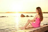 Beauty woman on the beach at sunset. Enjoy nature. Luxury girl r — Stock Photo