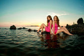 Two beautiful women on the beach at sunset. Enjoy nature. Luxury — Stock Photo