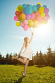 Young healthy beauty pregnant woman with balloons outdoors. A g — Stock Photo
