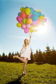 Young healthy beautiful pregnant woman with balloons outdoors. A — Stock Photo
