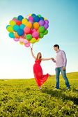 Young healthy beauty pregnant woman with her husband and balloon — Photo