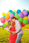 Young healthy beauty pregnant woman with her husband and balloon — Φωτογραφία Αρχείου