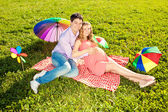 Young healthy beautiful pregnant woman with her husband and rain — Stockfoto