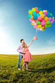 Young healthy beautiful pregnant woman with her husband and ball — Foto Stock
