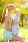 Smiling emotional kid with mum on a walk. Smile of a child — Stock Photo