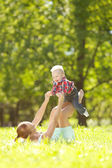 Cute little baby in the park with mother on the grass. Sweet bab — Stock Photo