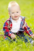 Cute little baby in summer park on the grass. Sweet baby outdoo — Stock Photo