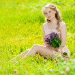 Young beauty smiling woman in the field, on the grass. Girl rest — Stock Photo